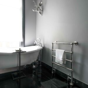 A traditional style chrome radiator offering lots of towel hanging space